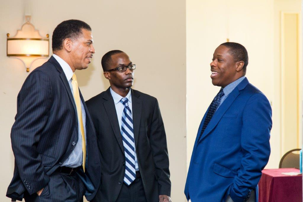 From L to R: Famguard Corporation President Lyrone Burrows and Famguard VP Finance Ramon Curtis with BISX CEO Keith Davies